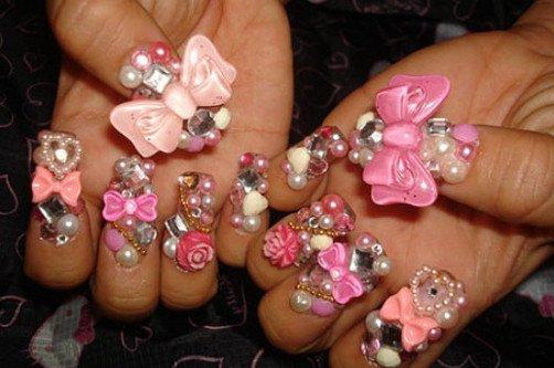 креативный дизайн ногтей с бантами и бусинами фото